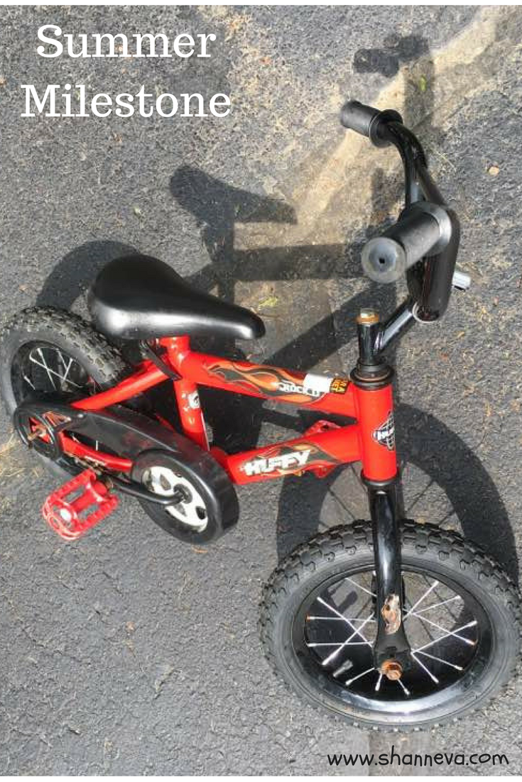 summer milestone. riding without training wheels. Big Boy Bike. Helmet safety.